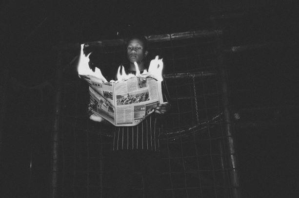 burning newspaper resize1